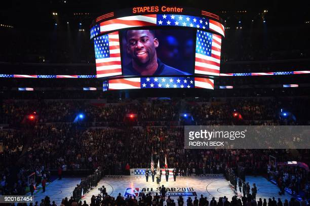 NBA AllStar Draymond Green listens as Fergie performs at the 2018 NBA AllStar Game February 18 2018 at Staples Center in Los Angeles California / AFP...
