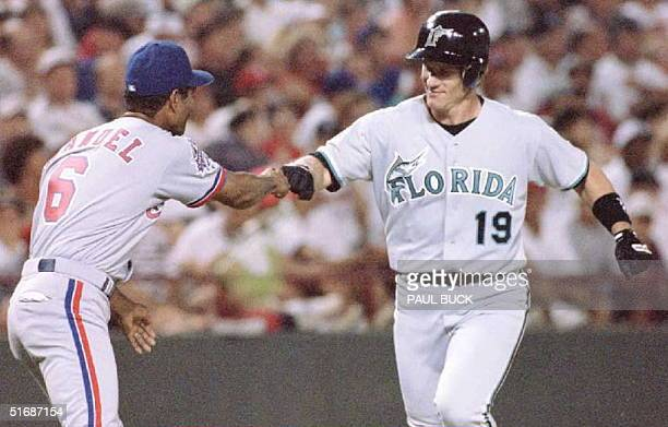 AllStar Game Most Valuable Player Jeff Conine of the National League's Florida Marlins is congratulated by third base coach Jerry Manuel after his...