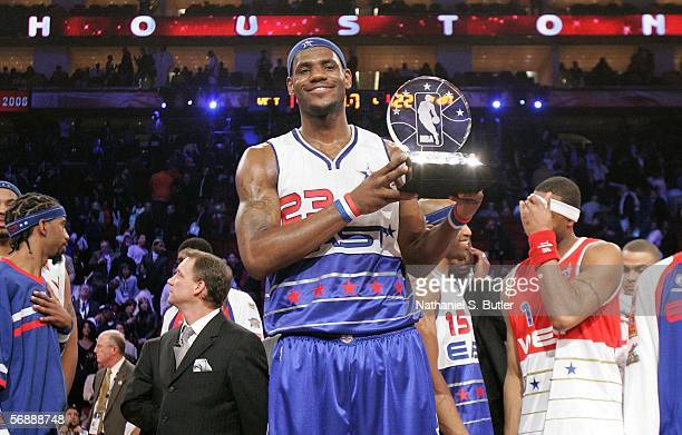AllStar Game Most Valuable Player LeBron James#23 of the Eastern Conference celebrates with the trophy following the East's 122120 win over the...
