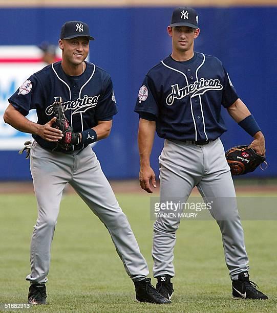 Allstar shortstop Derek Jeter and catcher Jorge Posada of the New York Yankees joke around during the practice for the 2002 Major League Baseball...