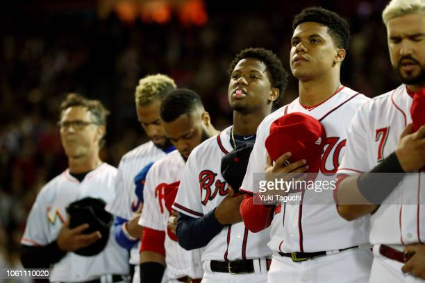 AllStars are seen on the base path during the playing of the national anthems prior to Game 4 of the Japan AllStar Series against Team Japan at Mazda...