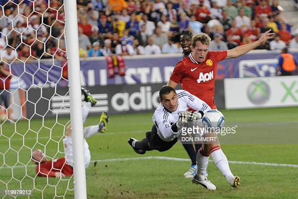 MLS AllStars goal keeper Faryd Mondragon punches the ball away in front of Manchester United Phil Jones during the friendly match between the MLS...