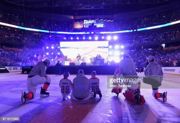 AllStars sit and watch as Kid Rock performs during the 2018 Honda NHL AllStar Game at Amalie Arena on January 28 2018 in Tampa Florida
