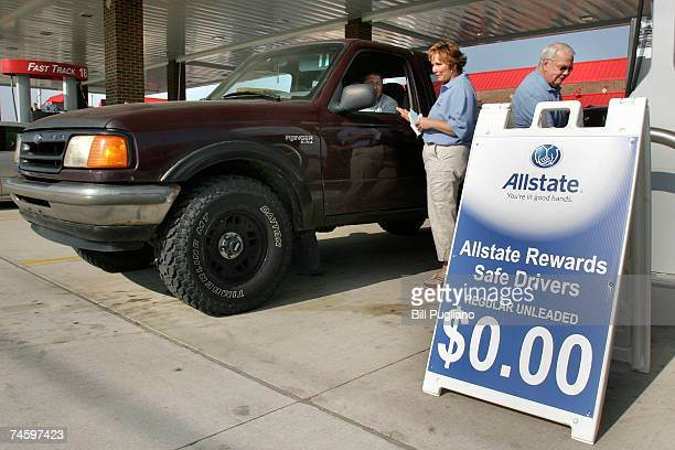 Allstate employees fill the tank of a car during a free gas promotion at a gas staion June 14 2007 Warren Michigan Hundreds of motorists lined up for...