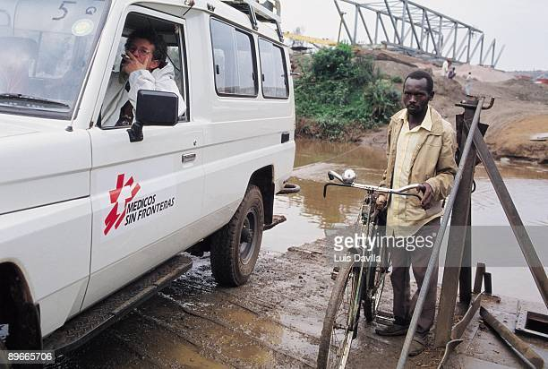 Allterrain vehicle of Doctors without Frontiers crossing a river Allterrain vehicle of Doctors without Frontiers crossing a river with address to the...