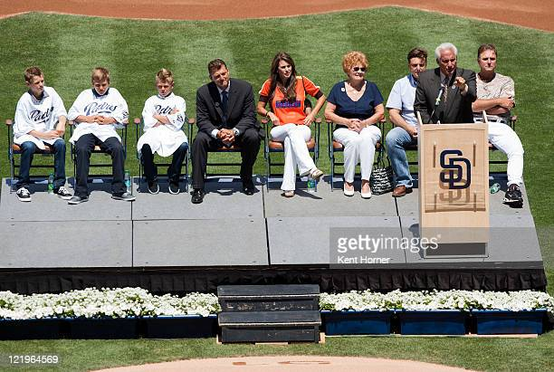 AllTime saves leader Trevor Hoffman sits with his family while announcer Ted Leitner speaks during his jersey retirement ceremony held by the San...