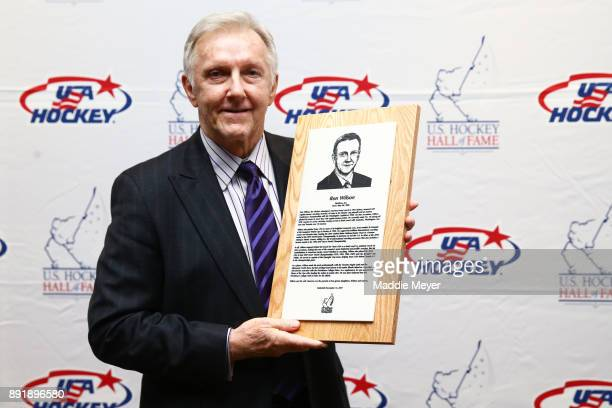 Alltime winningest American head coach in NHL history and former NHL player Ron Wilson stands with his plaque honoring him as an inductee into the US...