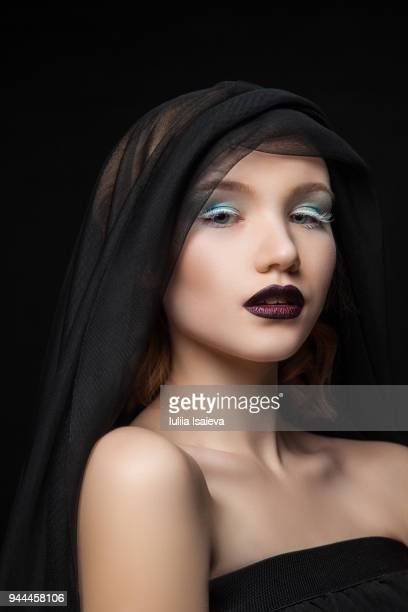 Alluring model with contrastive makeup under veil