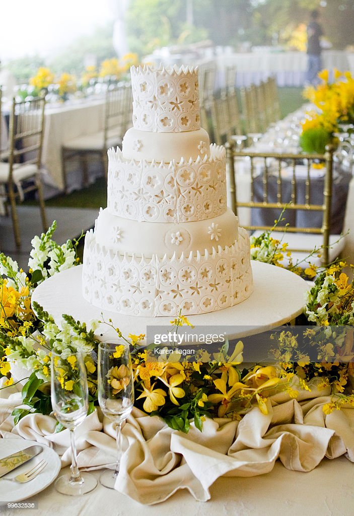 Allwhite Fondant Wedding Cake With A Lace Design Stock Photo Getty