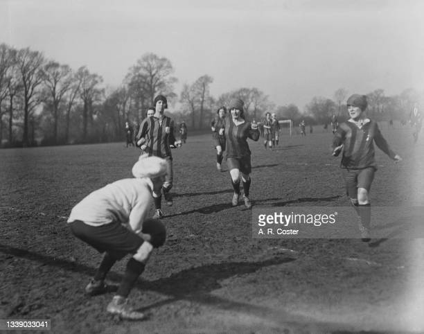 All-women teams of staff from rival Lyon's Corner Houses playing football at Sudbury, London, 4th March 1920. The teams are from the flagship Maison...