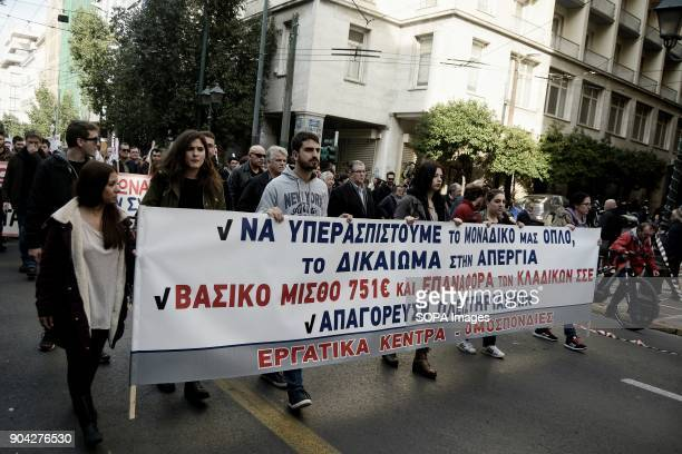 AllWorkers Militant Front members seen holding a large banner while taking part during the demonstration against the voting of the new Multibill of...