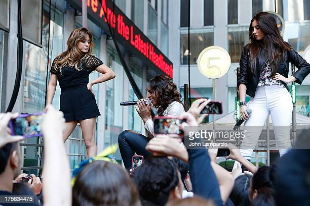 Ally Brooke Hernandez Normani Hamilton and Lauren Jauregui of Fifth Harmony perform during FOX Friends outside of FOX Studios on August 5 2013 in New...