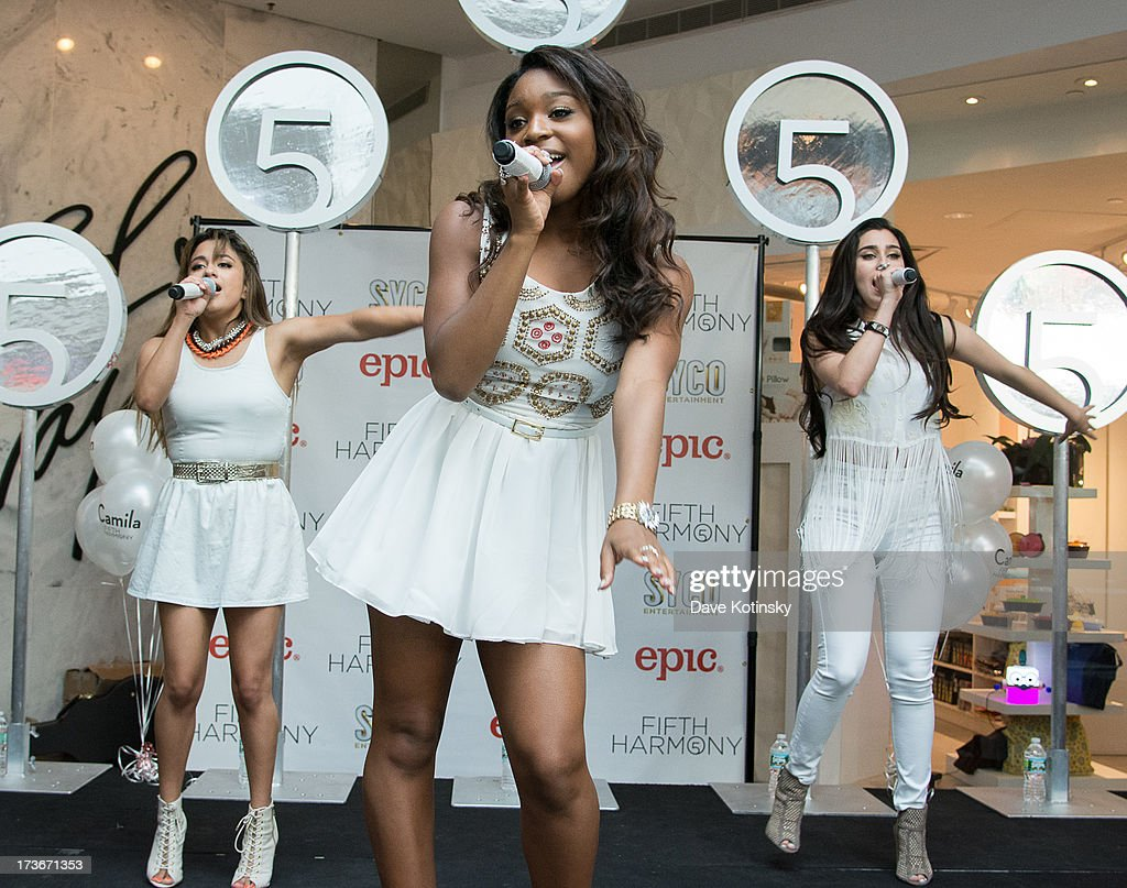 Ally Brooke, Normani Hamilton and Lauren Jauregui of Fifth Harmony perform at Garden State Plaza on July 16, 2013 in Paramus, New Jersey.