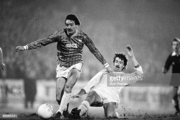 Ally Brown of Walsall is tackled by Mark Lawrenson of Liverpool during the Walsall v Liverpool Milk Cup SemiFinal 2nd leg match played at Fellows...