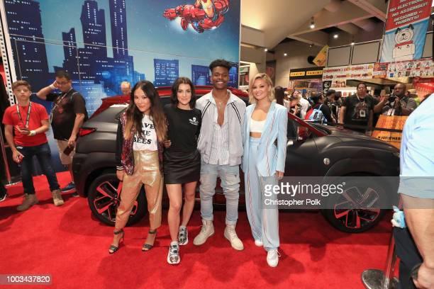 Ally Maki Emma Lahana Aubrey Joseph and Olivia Holt of Marvel's Cloak and Dagger stop by the Marvel booth to pose with the Hyundai Kona Iron Man...