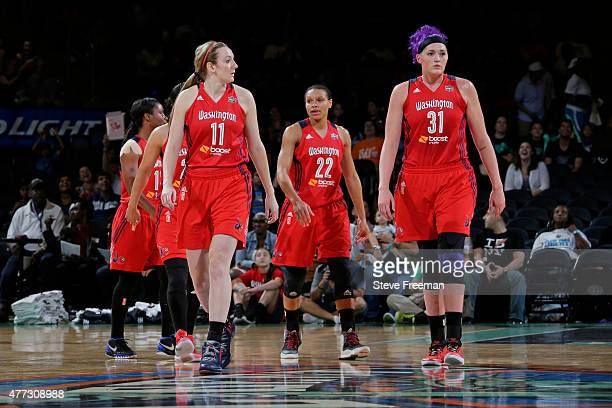 Ally Malott and Stefanie Dolson of the Washington Mystics walk off the court against the New York LIberty on June 14 2015 at Madison Square Garden in...
