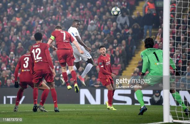 Ally Mbwana Samatta of KRC Genk scores his team's first goal during the UEFA Champions League group E match between Liverpool FC and KRC Genk at...