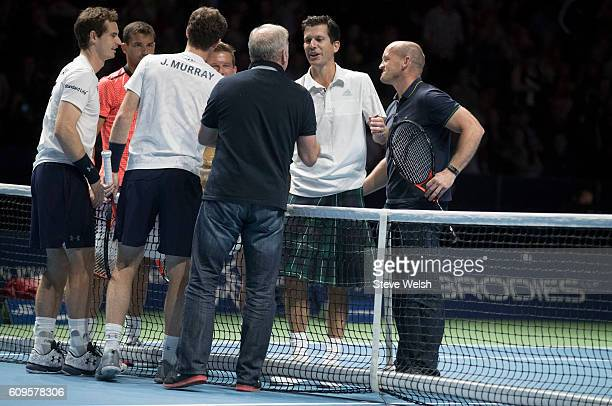 Ally McCoist and Tim Henman at the end of their doubles match during Andy Murray Live presented by SSE at the SSE Hydro on September 21 2016 in...