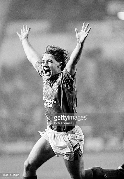 Ally McCoist celebrates after scoring the winning goal for Glasgow Rangers in a Scottish Premier Division match against Motherwell held at Ibrox...