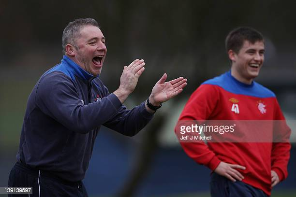 Ally McCoist coach of Rangers takes part in a training session with his players at Murray Park on February 17 2012 in Glasgow Scotland Rangers face...