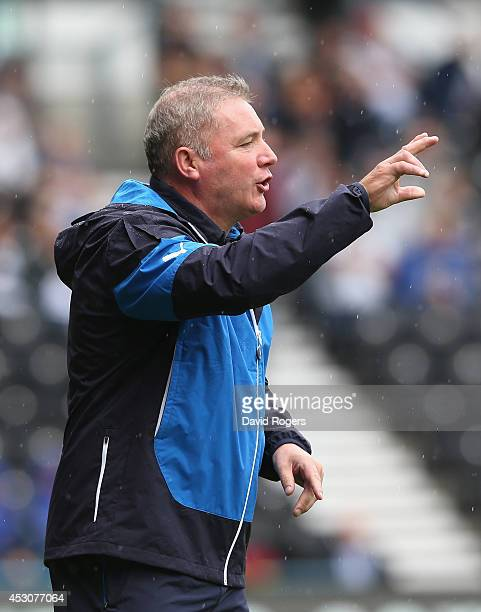 Ally McCoist the Rangers manager issues instructions during the pre season friendly match between Derby County and Rangers at iPro Stadium on August...
