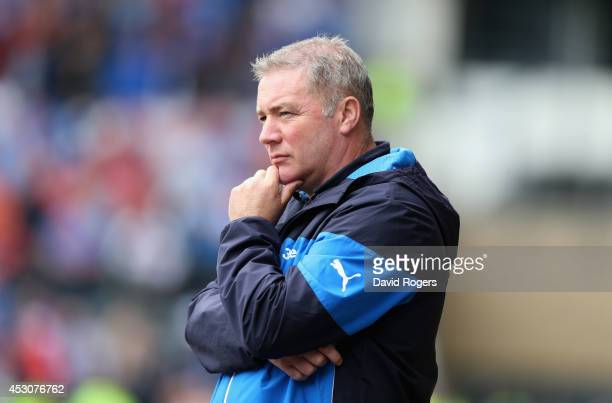Ally McCoist the Rangers manager looks on during the pre season friendly match between Derby County and Rangers at iPro Stadium on August 2 2014 in...