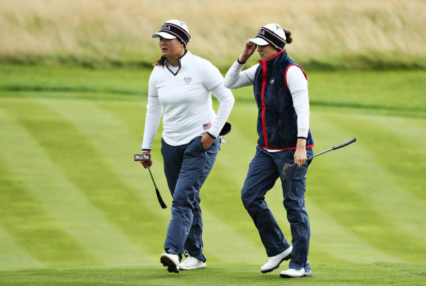 Ally McDonald and Angel Yin of Team USA walk off the fourth green during Day 2 of the Solheim Cup at Gleneagles on September 14 2019 in Auchterarder...