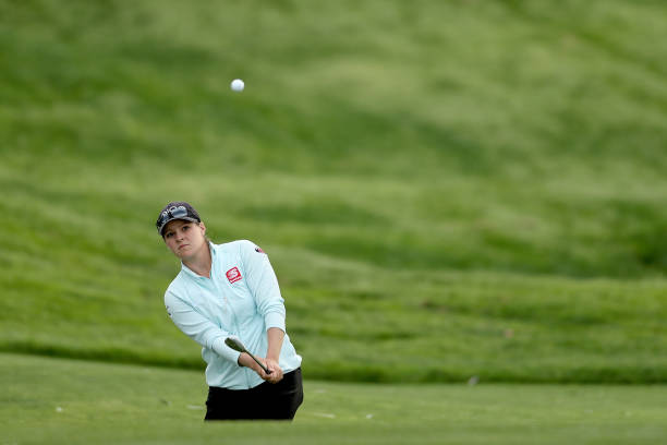Ally McDonald hits out of a bunker onto the 17th green during round 1 of the ANA Inspiration on the Dinah Shore course at Mission Hills Country Club...
