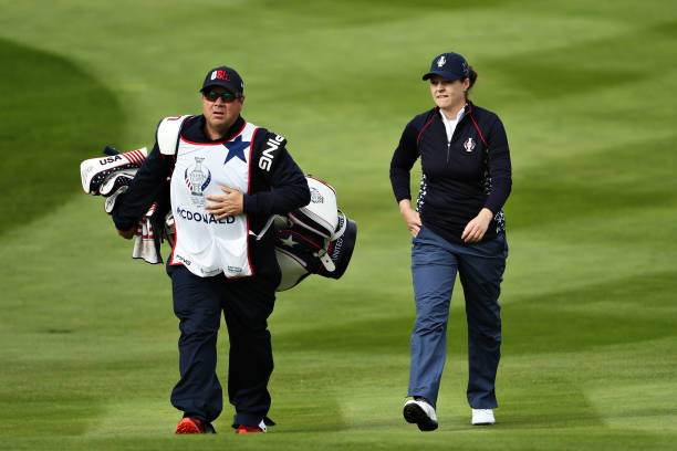 Ally McDonald of Team USA walks on the first hole in her match with Bronte Law of Team Europe during the final day singles matches of the Solheim Cup...