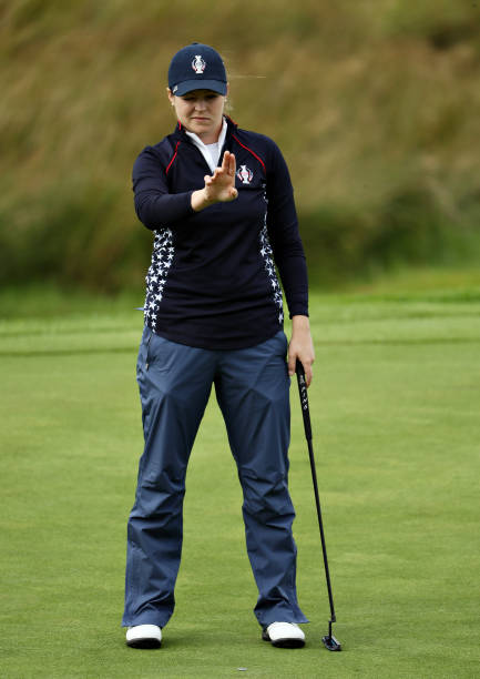 Ally McDonald of Team USA watches her putt on the first hole in her match with Bronte Law of Team Europe during the final day singles matches of the...