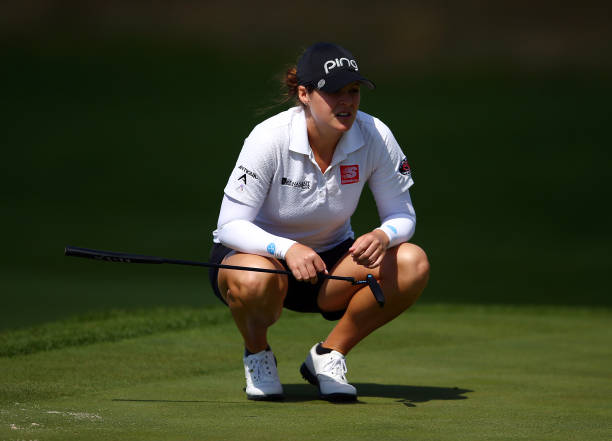 Ally McDonald of the United States eyes up a putt on the 12th green during the first round of the CP Women's Open at Magna Golf Club on August 22...