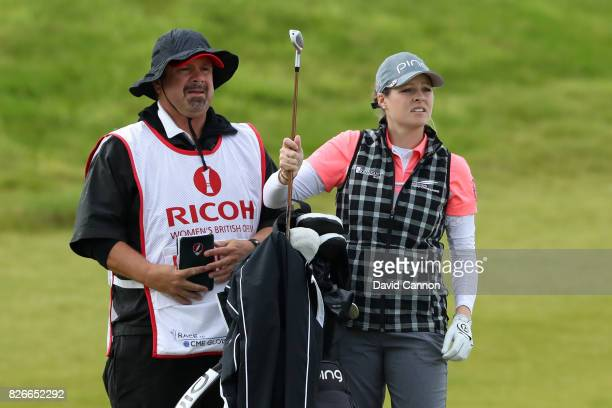 Ally McDonald of the United States selects a club during the third round of the Ricoh Women's British Open at Kingsbarns Golf Links on August 5 2017...