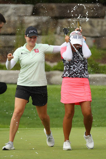 Ally McDonald of the United States showers Jasmine Suwannapura of Thailand after her win at the Dow Great Lakes Bay Invitational at Midland Country...