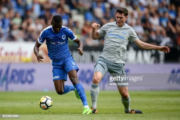 Ally Samatta from KRC Genk is challenged by Michael Keane from Everton during the PreSeason Friendly between KRC Genk and Everton at Cristal Arena on...