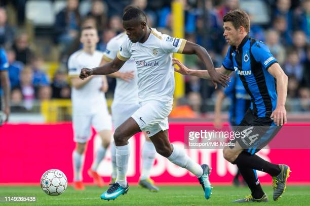 Ally Samatta of Genk and Brandon Mechele of Club Brugge fight for the ball during the Jupiler Pro League playoff 1 match between Club Brugge and Krc...
