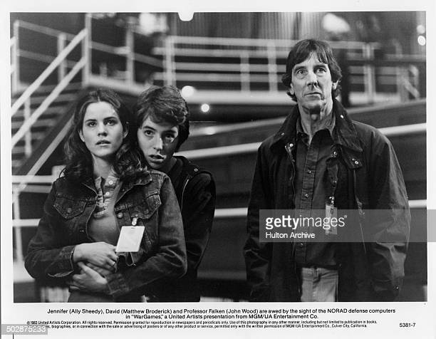 Ally Sheedy Matthew Broderick and John Wood watch the NORAD defense computers in a scene for the MGM/UA movie 'WarGames' circa 1983