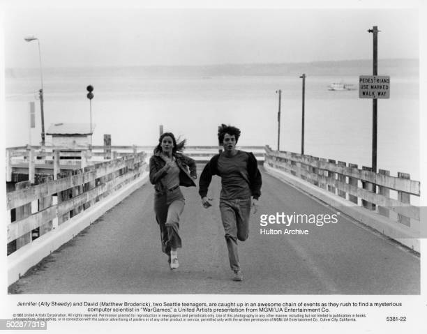 Ally Sheedy Matthew Broderick run in a scene for the MGM/UA movie 'WarGames' circa 1983