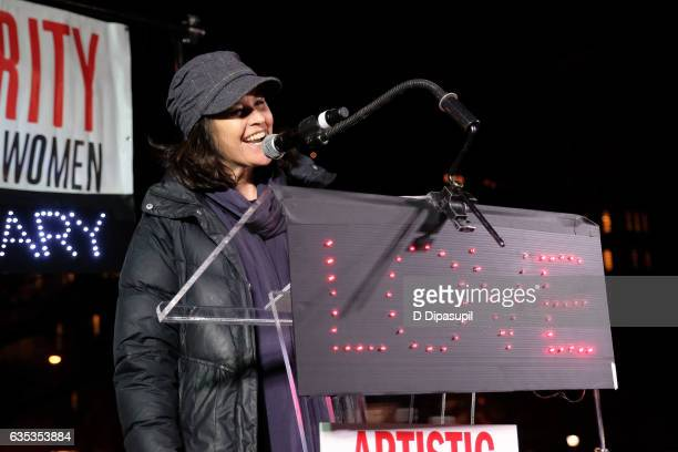 Ally Sheedy speaks onstage during Artistic Uprising A Call For #RevolutionaryLove at Washington Square Park on February 14 2017 in New York City