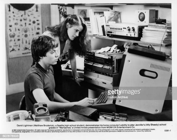 Ally Sheedy watches Matthew Broderick computer in a scene for the MGM/UA movie 'WarGames' circa 1983