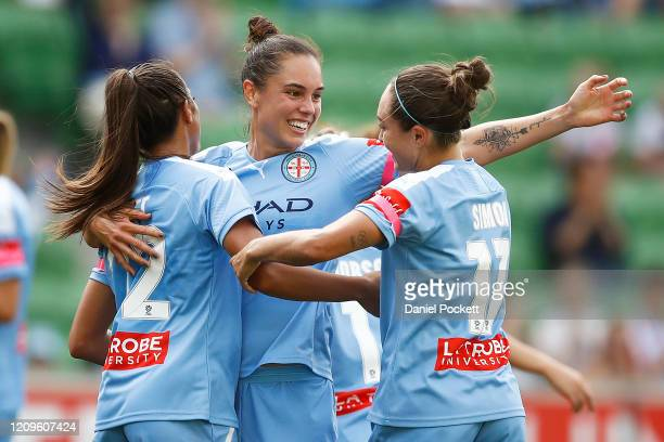 Ally Watt of Melbourne City celebrates with Emma Checker of Melbourne City and Kyah Simon of Melbourne City after scoring a goal during the round 14...