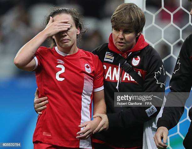 Allysha Chapman of Canada leaves the ground with an injury during the Women's Football Quarter Final match between Canada and France on Day 7 of the...