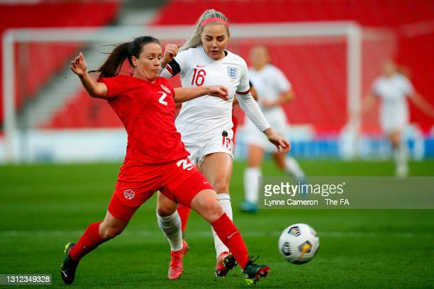 Allysha Chapman of Canada passes the ball under pressure from Alex Greenwood of England during the International Friendly match between England and...