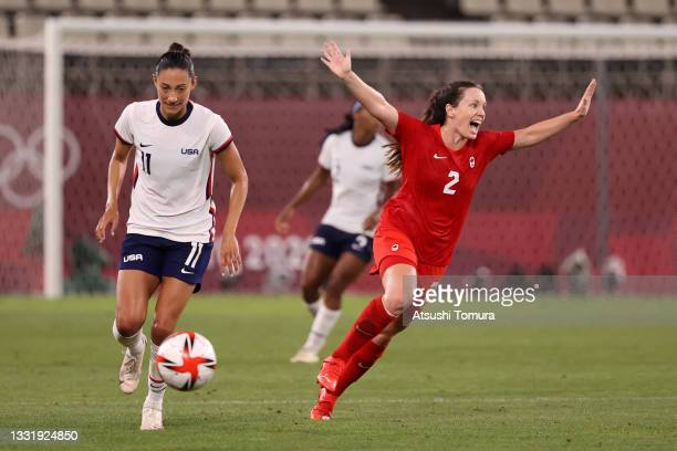 Allysha Chapman of Team Canada celebrates victory at full time as Christen Press of Team United States looks dejected after the Women's Semi-Final...