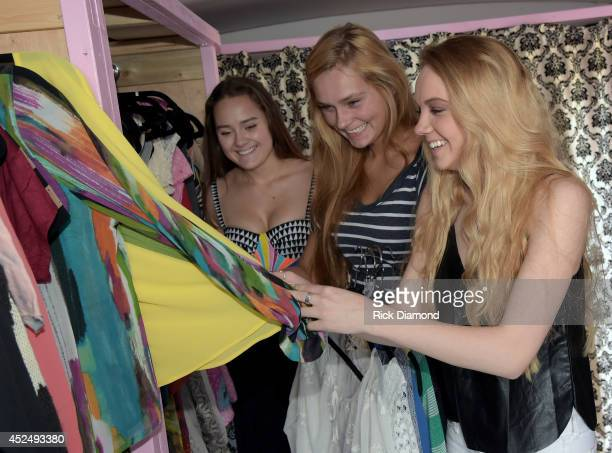 Allyson Ahlstrom founder Threads for Teens and Season 4 winner of The Voice Danielle Bradbery helps a teen in the style studio at the Threads For...