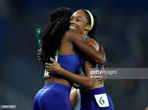 Allyson Felix and Courtney Okolo of the United States react after winning gold in the Women's 4 x 400 meter Relay on Day 15 of the Rio 2016 Olympic...