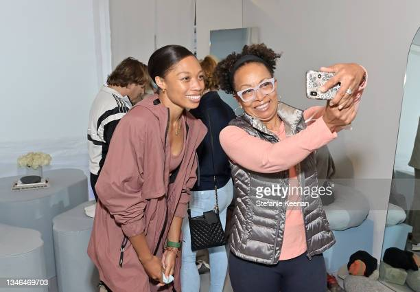Allyson Felix and guest attend a work out led by Megan Roup from The Sculpt Society as Olympian Allyson Felix opens Saysh's new experiential space on...