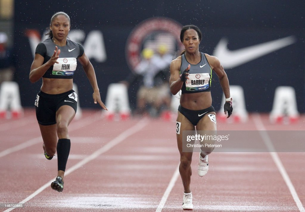 Allyson Felix and Miki Barber compete in a preliminary round of the women's 100 meter dash during Day One of the 2012 U.S. Olympic Track & Field Team Trials at Hayward Field on June 22, 2012 in Eugene, Oregon.