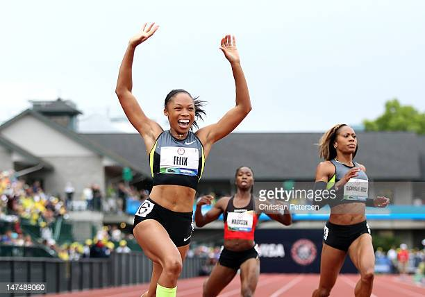 Allyson Felix celebrates after winning the Women's 200 Meter Dash Final on day nine of the US Olympic Track Field Team Trials at the Hayward Field on...