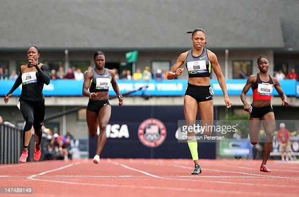 Allyson Felix crosses the finish line to win the Women's 200 Meter Dash Final ahead of Carmelita Jeter Jeneba Tarmoh and Tianna Madison on day nine...