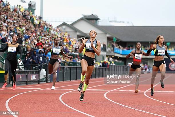 Allyson Felix crosses the finish line to win the Women's 200 Meter Dash Final ahead of Carmelita Jeter Jeneba Tarmoh Tianna Madison and Sanya...